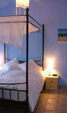 Bedroom with original art - holiday accommodation in Aude