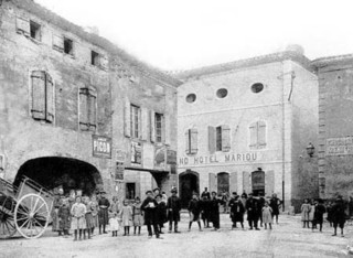 Old black and white photo of the square in Couiza, Languedoc Roussillon